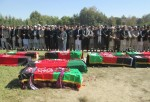 Afghan men offer funeral prayers in front of the bodies of people killed in an earthquake  in Takhar province, northeast of Kabul, Afghanistan, Tuesday, Oct. 27, 2015. Rescuers were struggling to reach quake-stricken regions in Pakistan and Afghanistan on Tuesday as officials said the combined death toll from the previous day's earthquake rose to more than 300. (AP Photo/Naim Rahimi)