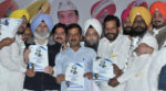 AAP national convener and Delhi CM Arvind Kejriwal along with AAP leaders releases the Dalit manifesto during a rally at Goraya in Jalandhar dist. on Friday.Tribune Photo:Malkiat Singh
