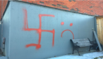 some-of-the-graffiti-spray-painted-on-the-sikh-society-of-calgary-building-cbc